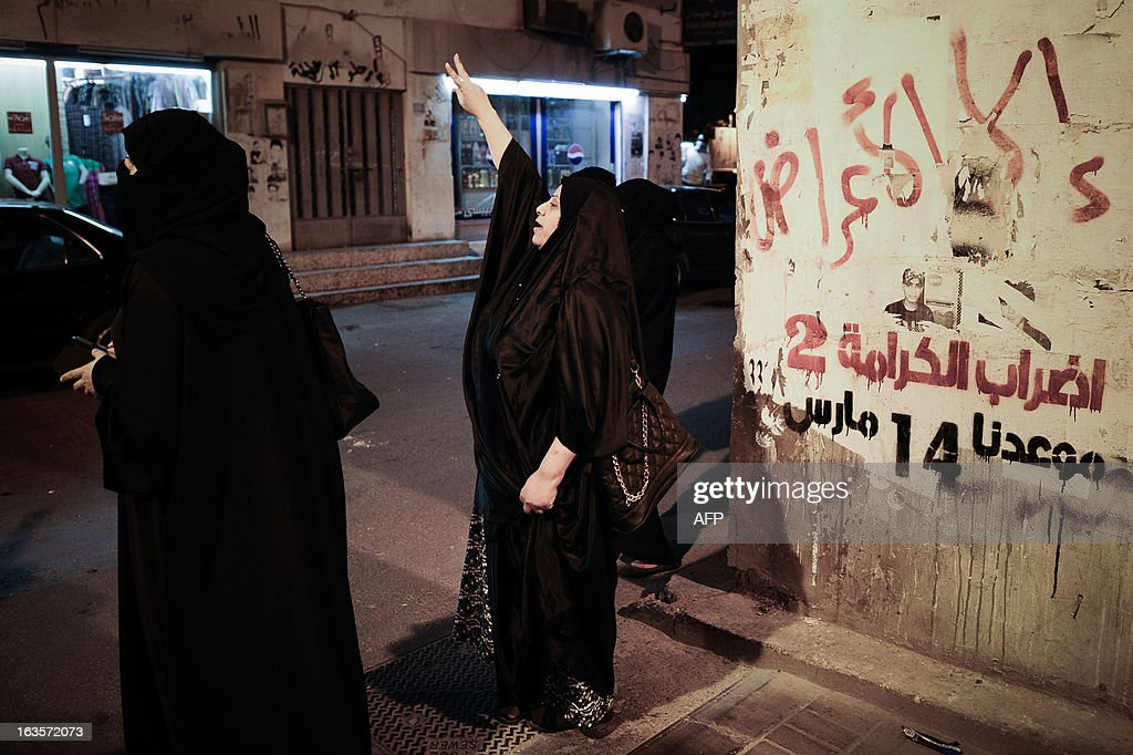 Bahraini Woman flashing 'V' sign for victory during an anti-government protest in the village of Sanabis, West of Manama on March 12, 2013. Bahrain's opposition groups, plan to stage protests this week to mark the second anniversary of the entry of Saudi troops to Bahrain during an uprising in the Sunni-ruled kingdom on March 2011.