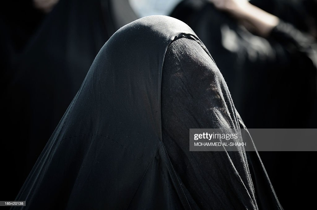 A Bahraini woman mourns during the funeral of Bahraini political prisoner Hussain Mahdi Habib in the village of Sitra, south of Manama, on October 20, 2013. Habib, 20, who escaped from prison on May 19, was found dead on October 19, after he was allegedly shot near the coastal village of al-Malkiyah. AFP PHOTO/MOHAMMED AL-SHAIKH
