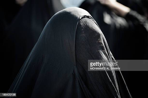 A Bahraini woman mourns during the funeral of Bahraini political prisoner Hussain Mahdi Habib in the village of Sitra south of Manama on October 20...