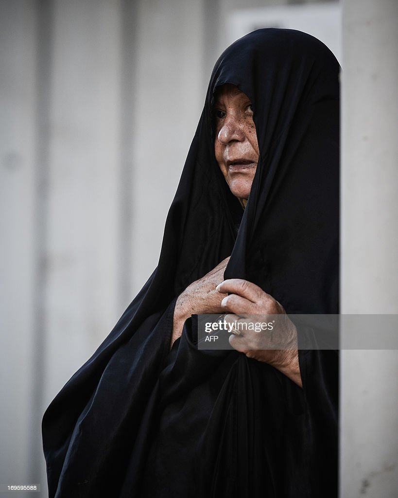 A Bahraini woman mourns during the funeral of Sayed Omran Sayed Hameed on May 28, 2013 in the village of Karzakkan, south of Manama. Hameed, 26, died at hospital after developing respiratory complications and his relatives claim that his death is due to the inhalation of poisonous tear gas that riot police used during a protest in May 2013. AFP PHOTO/MOHAMMED AL-SHAIKH