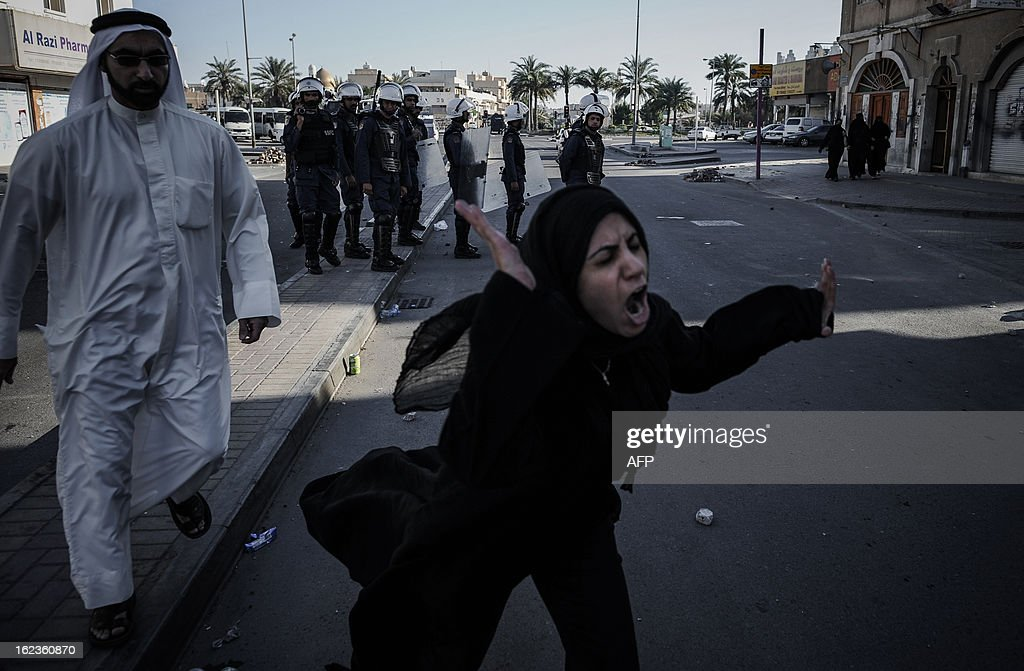 A Bahraini woman reacts as her son is arrested during clashes with riot police following an anti-regime protest against the killing of 20-year old Mahmud al-Jaziri, in the village of Daih, West of Manama, on February 22, 2013. The Shiite protester died of wounds after he was shot during clashes with Bahraini police on the second anniversary of the February 14, 2011 uprising.