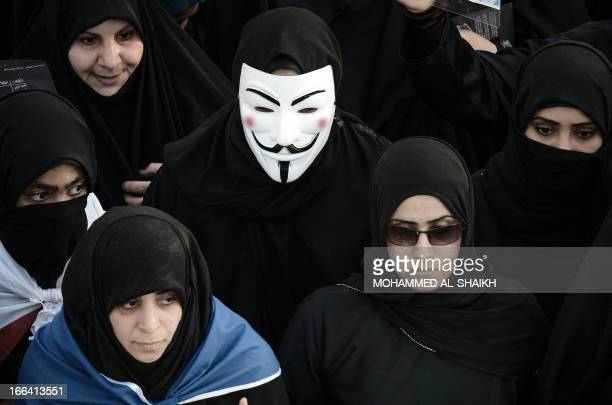 A Bahraini woman wears a Guy Fawkes mask used by the Anonymous movement during an antiregime rally to claim that democracy is their right and to...