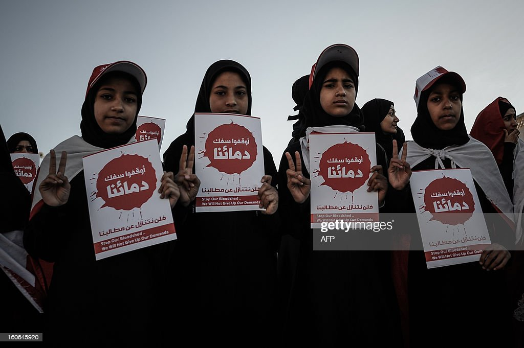 Bahraini women hold placards reading in Arabic 'Stop spilling our blood' during an anti-government rally to demand reforms on February 4, 2013 in the city of Muharraq, east of the Bahraini capital Manama. Bahrain's justice ministry announced that national talks aimed to end the kingdom's political stalemate will resume on February 10, 2013 after an earlier round failed to bring the opposition onboard.