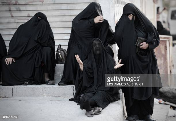 Bahraini women mourn on April 22 in the village of alMaqsha west of Manama during the funeral of Ahmed alMosajen and Ali Abbas who were killed when...