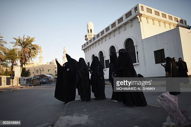 Bahraini women shout slogan during clashes with riot police following a protest against the execution of prominent Shiite Muslim cleric Nimr alNimr...