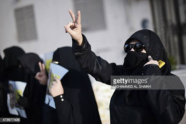 Bahraini women take part in a demonstration against the arrest of Sheikh Ali Salman head of the Shiite opposition movement alWefaq on May 19 2015 in...