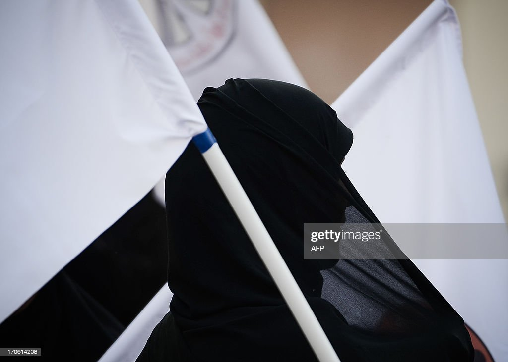 A Bahraini women takes part in a protest to demand more rights in the village of Bilad al-Qadeem, in a suburb of Manama, on June 15, 2013. Weekly protests, that began in 2011, are held by Bahraini Shiite Muslims demanding more rights from the ruling Sunni Muslim dynasty. AFP PHOTO/MOHAMMED AL-SHAIKH