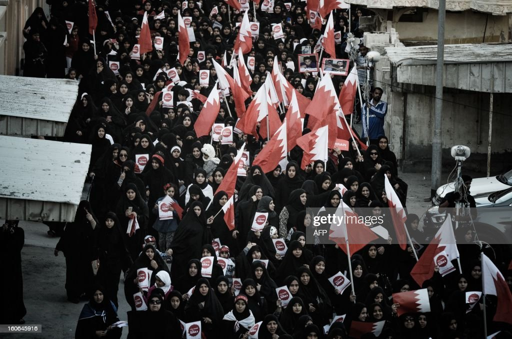 Bahraini women wave national flags during an anti-government rally to demand reforms on February 4, 2013 in the city of Muharraq, east of the Bahraini capital Manama. Bahrain's justice ministry announced that national talks aimed to end the kingdom's political stalemate will resume on February 10, 2013 after an earlier round failed to bring the opposition onboard.