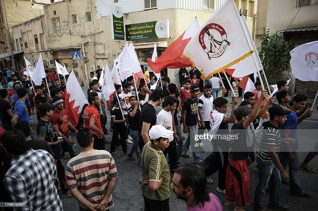 Bahrainis take part in a protest to demand more rights in the village of Bilad al-Qadeem, in a suburb of Manama, on June 15, 2013. Weekly protests, that began in 2011, are held by Bahraini Shiite Muslims demanding more rights from the ruling Sunni Muslim dynasty.