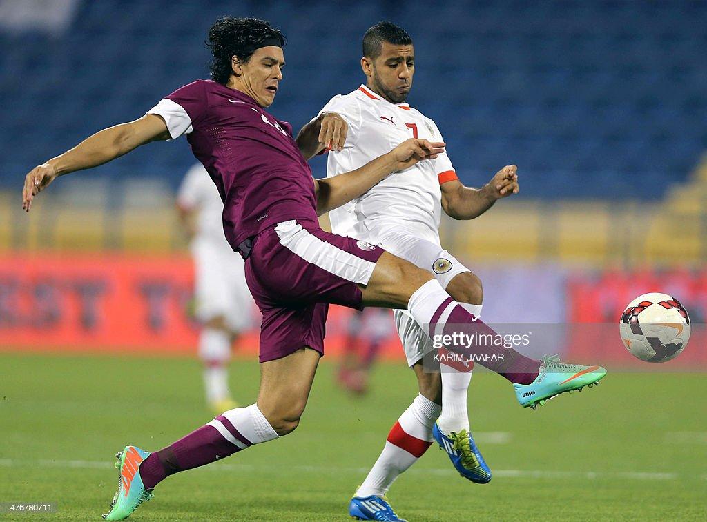 Bahrain's Abdulwahab Ali challenges Qatar's Sebastian Soria during their Asian Cup qualifying group D football match in the Thani Bin Jassim Stadium...