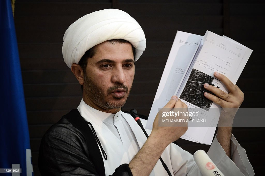 Bahrain's Al-Wefaq opposition group leader Sheikh Ali Salman displays a document during a press conference in the village of Zinj, west of Manama, on July 4, 2013. A Bahraini court sentenced seven Shiite men to 15 years in prison on July 2, for the attempted murder of a police officer in August 2012, a judicial source said.