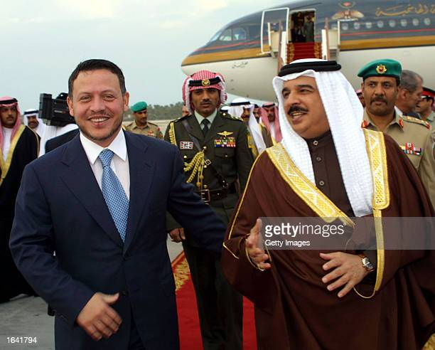 Bahrain's Emir Sheikh Hamad bin Issa alKhalifa receives King Abdullah II of Jordan at Manama airport January 9 2002 in Bahrain The Jordanian monarch...