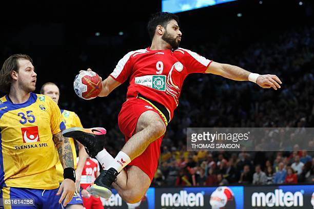 Bahrain's Hasan Mohamed Alsamahiji jumps to shoot past Sweden's pivot Andreas Nilsson during the 25th IHF Men's World Championship 2017 Group D...