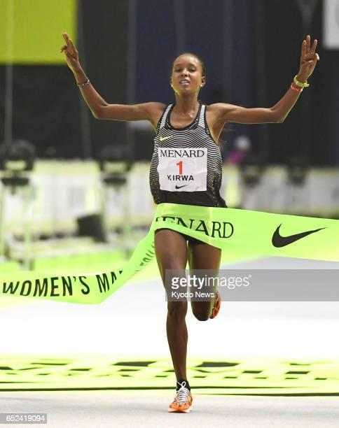 Bahrain's Kenyanborn star Eunice Kirwa crosses the finish line to win the Nagoya Women's Marathon in the central Japanese city of Nagoya on March 12...