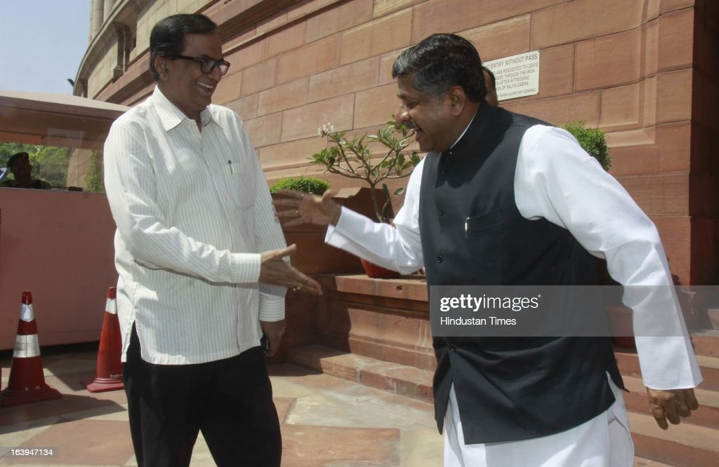 Bahujan Samaj party leader Satish Mishra greets BJP leader Ravi Shankar Prasad after attending the ongoing parliament budget session on March 18, 2013 in New Delhi, India. Samajwadi Party members today disrupted both houses of parliament demanding the sacking of Steel Minister Beni Prasad Verma over his alleged comments that their party chief Mulayam Singh Yadav had terrorist links.