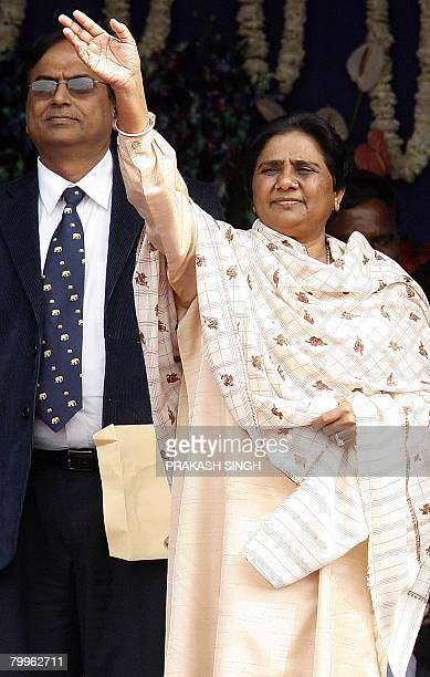 Bahujan Samaj Party President and Chief Minister of the Indian state of Uttar Pradesh Mayawati waves as BSP's National General Secretary Satish Misra...