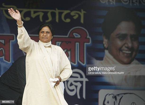Bahujan Samaj Party President and Uttar Pradesh state Chief Minister Mayawati Kumari greets supporters on her arrival at an election rally at Sahid...