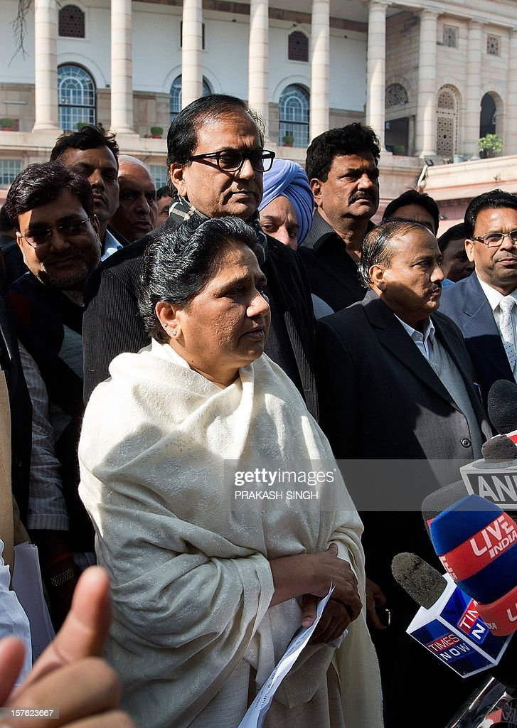 Bahujan Samaj Party (BSP) President Mayawati (C) addresses the media outside Parliament house during the winter session in New Delhi on December 5, 2012. India's government, which lost its majority in September, faced a test of its ability to marshal support in parliament on Wednesday with a vote on a contentious recent reform of the retail sector. After two days of stormy debating in the rowdy lower house, lawmakers are set to pass judgement on new rules opening up the highly protected retail sector to foreign supermarkets that are being allowed in for the first time. AFP PHOTO/ Prakash SINGH