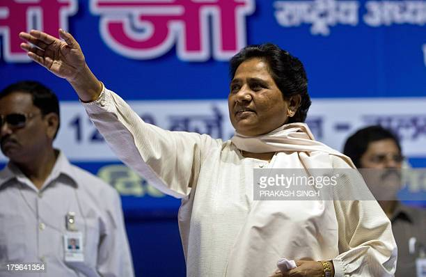 Bahujan Samaj Party President Mayawati waves during a meeting with party workers in New Delhi on September 6 2013 Mayawati told journalists the...