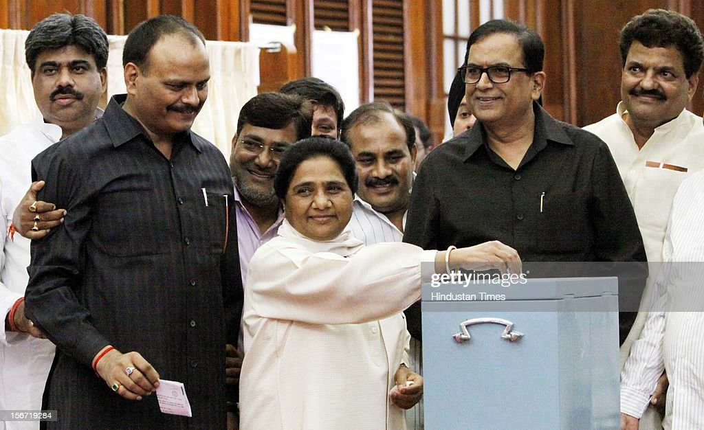 'NEW DELHI, INDIA - AUGUST 7: Bahujan Samaj Party Supremo Mayawati along with party MP's casting her vote for the election of Vice President at Parliament house on August 7, 2012 in New Delhi, India. (Photo by Sunil Saxena/Hindustan Times via Getty Images)'