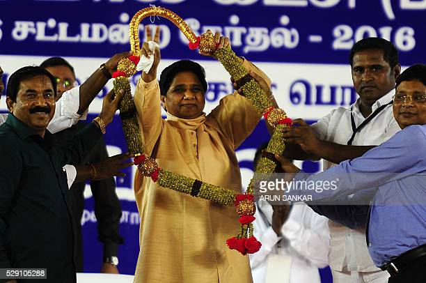 Bahujan Samaj Partyleader Mayawati is garlanded by supporters during an election rally in Chennai on May 8 ahead of voting in state assembly...