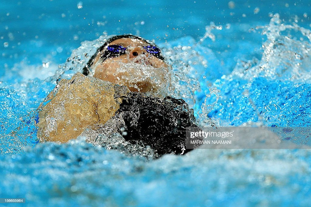 Bai Anqi of China competes to win the Women's 200m backstroke final during the 9th Asian Swimming Championships in Dubai, on November 18, 2012. AFP PHOTO/MARWAN NAAMANI