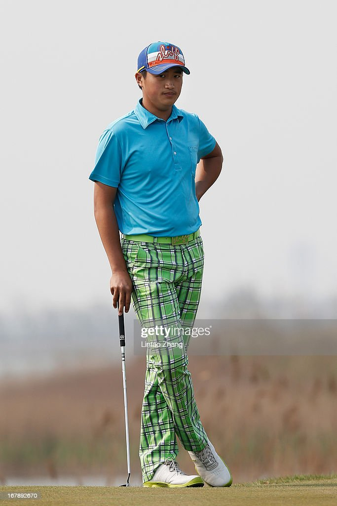 Bai Zheng-kai looks on during the first day of the Volvo China Open at Binhai Lake Golf Course on May 2, 2013 in Tianjin, China.