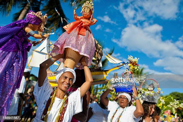 Baiana women carry religious figurines during the ritual procession in honor to Yemanjá the Candomblé goddess of the sea on February 03 in Amoreiras...