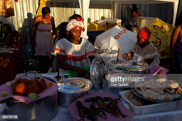 Baianas sell Acaraje and other typical food from Bahia in the BarraOndina street carnival track on February 24 2009 in Salvador Brazil