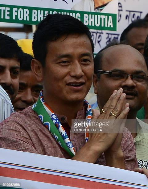 Baichung Bhutia former Indian football team captain and Trinamool Congress candidate for the Darjeeling constituency campaigns in the streets of...