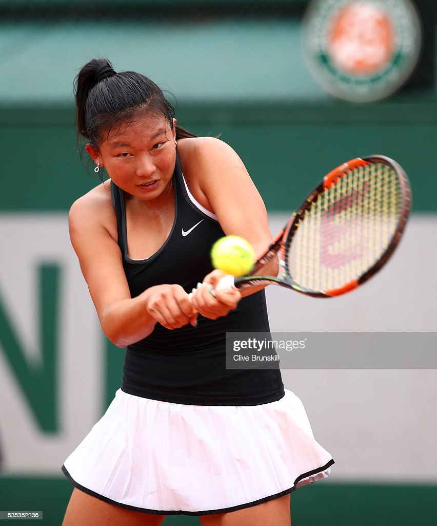 Baijing Lin of Australia hits a backhand during the Girls Singles first round match against Lucrezia Stefanini of Italy on day eight of the 2016 French Open at Roland Garros on May 29, 2016 in Paris, France.