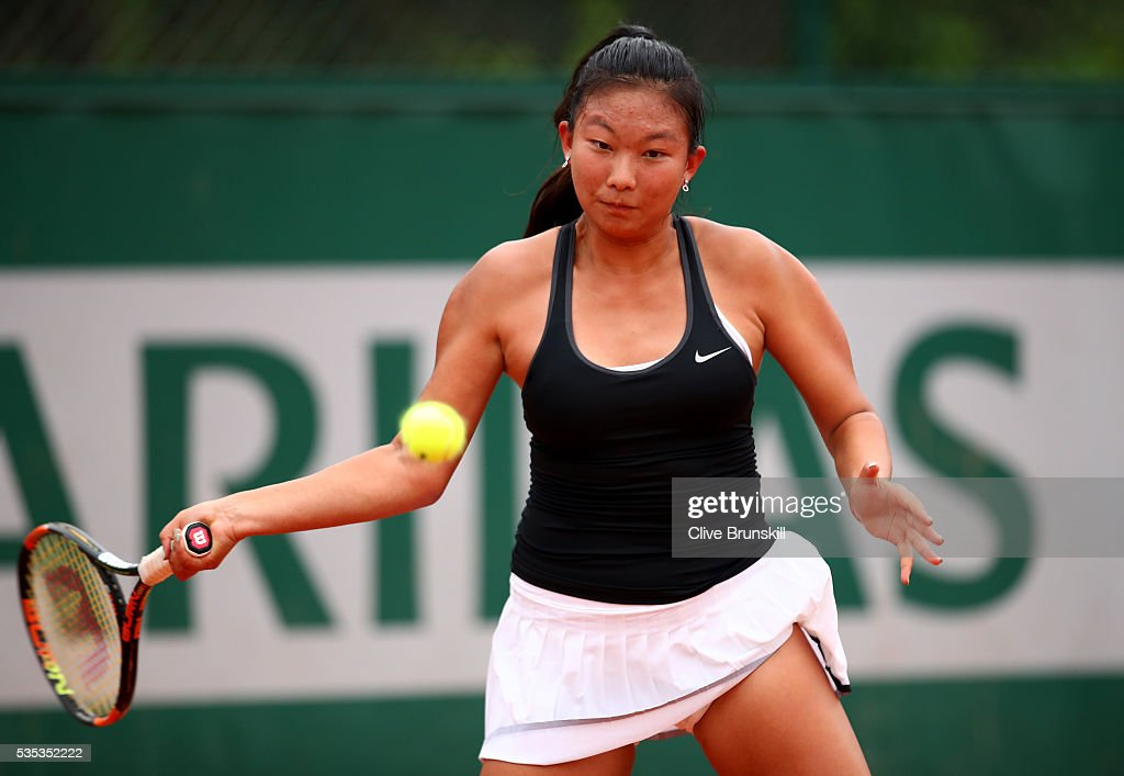 Baijing Lin of Australia hits a forehand during the Girls Singles first round match against Lucrezia Stefanini of Italy on day eight of the 2016 French Open at Roland Garros on May 29, 2016 in Paris, France.