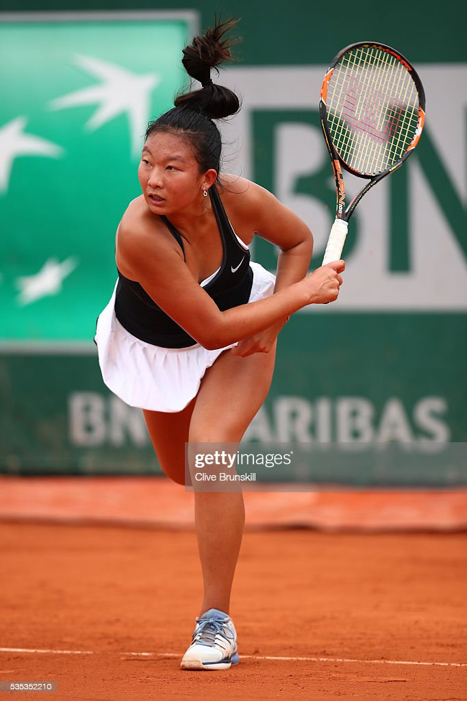 Baijing Lin of Australia serves during the Girls Singles first round match against Lucrezia Stefanini of Italy on day eight of the 2016 French Open at Roland Garros on May 29, 2016 in Paris, France.