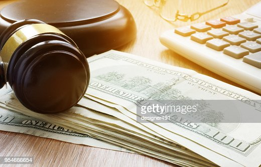 Bail bond concept. Gavel and dollar banknotes. : Stock Photo