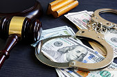 Bail bond. Corruption. Gavel, handcuffs and money.