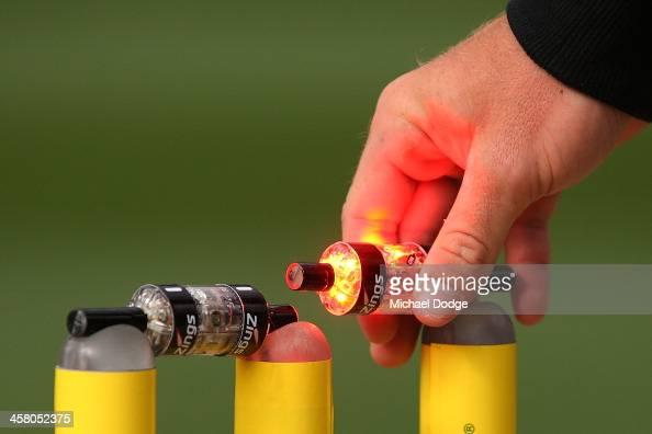 A bail lights up after being lifted up by a Channel Ten staff member during the Big Bash League match between the Melbourne Stars and the Melbourne...