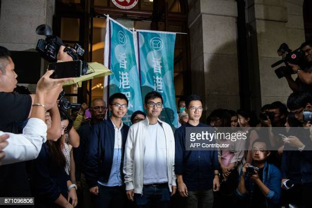 Bailed democracy activists Joshua Wong Alex Chow and Nathan Law speak to the press outside the Court of Final Appeal after the first hearing in their...