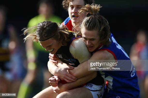 Bailey Beck of the Power tackles Zane Barzen of the Murray Bushrangers during the TAC Cup round 18 match between Gippsland and Murray at Victoria...