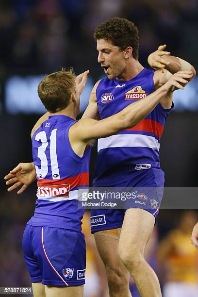 Bailey Dale of the Bulldogs celebrates a goal after the final siren with Tom Liberatore during the round seven AFL match between the Western Bulldogs...