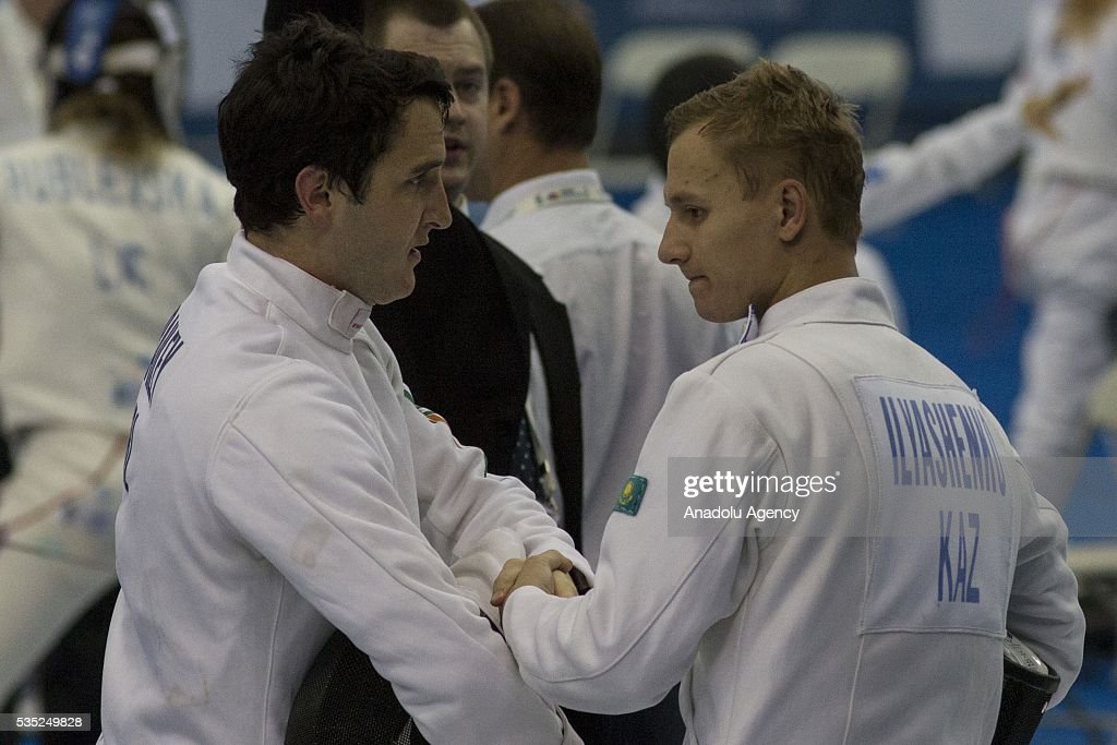 Bailey Eanna (L) from Ireland and Ilyashenko Pavel from Kazakhstan compete in the fencing at the mixed relay World Championship in modern pentathlon in Olympic Sports Complex in Moscow, Russia, on May 29, 2016.