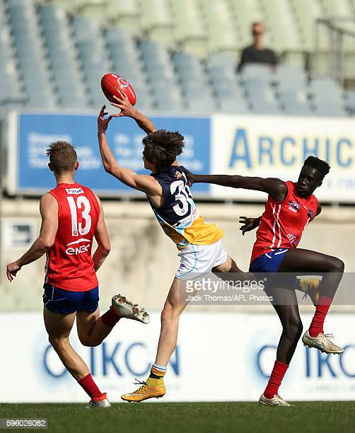 Bailey Henderson of the Pioneers attempts to mark the ball during the round 18 TAC Cup match between Gippsland Power and Bendigo Pioneers at Ikon...