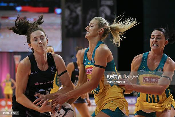 Bailey Mes of New Zealand battles with Laura Geitz and Sharni Layton both of Australia during the International Test match between the New Zealand...