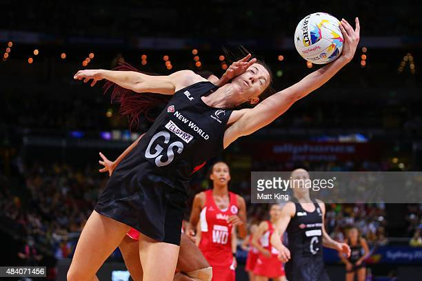 Bailey Mes of New Zealand is challenged by Geva Mentor of England during the 2015 Netball World Cup Semi Final 1 match between New Zealand and...