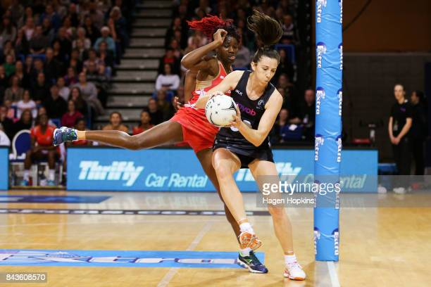 Bailey Mes of New Zealand receives a pass under pressure from Ama Agbeze of England during the International test match between the New Zealand...
