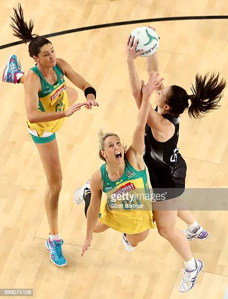 Bailey Mes of the Silver Ferns and Clare McMeniman and Sharni Layton of the Diamonds compete for the ball during the International Test match between...