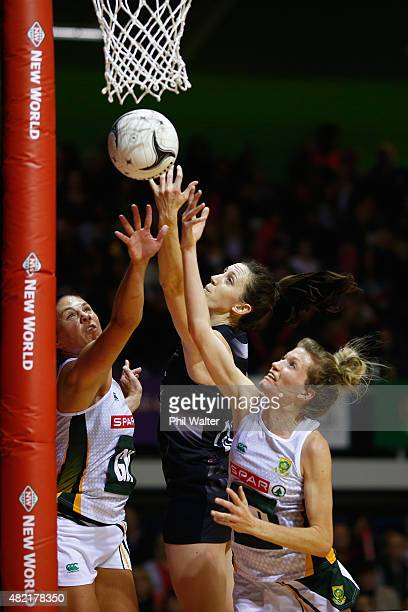Bailey Mes of the Silver Ferns is put under pressure from Karla Mostert and Adele Niemand of the Proteas during the International Test Match between...