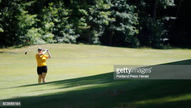 Bailey Plourde follows through a shot on the 12th fairway in the final round of the Maine Women's Amateur golf tournament at Martindale Country Club