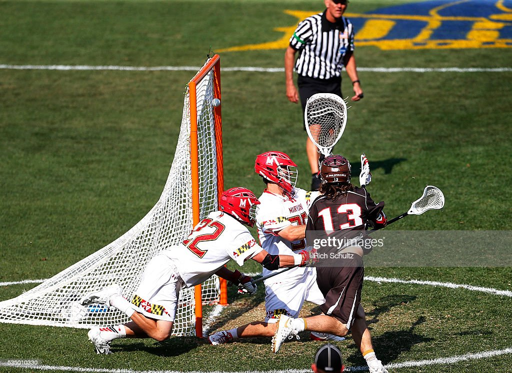 Bailey Tills #13 of the Brown Bears scores a goal past Greg Danseglio #22 and goalie Kyle Bernlohr #35 of the Maryland Terrapins in the third quarter during a semi final match in the NCAA Division I Men's Lacrosse Championship at Lincoln Financial Field on May 28, 2016 in Philadelphia, Pennsylvania. The goal sent the game into overtime and was won by Maryland 15-14.