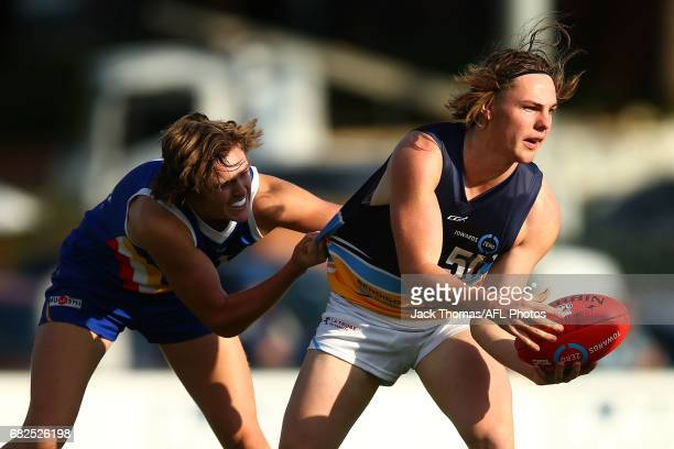 Bailey Waasdorp of the Pioneers looks to handball during the round seven TAC Cup match between the Eastern Ranges and the Bendigo Pioneers at Box...