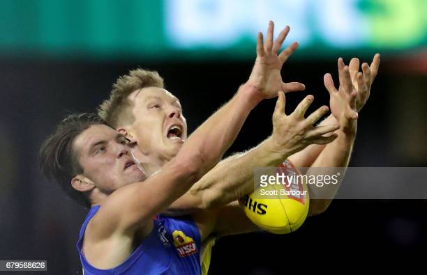 Bailey Williams of the Bulldogs and Jack Riewoldt of the Tigers compete for the ball during the round seven AFL match between the Western Bulldogs...